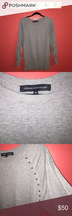 FRENCH CONNECTION JUMPER Grey sweater with grommet detailing along chest, shoulders, back, and sleeve. Purchased on holiday in England at a French Connection store. Material is rubbed along waist and bracelet of sleeves. Full length sleeves. No longer my personal style. Would look great with leather trousers and booties. French Connection Sweaters Crew & Scoop Necks