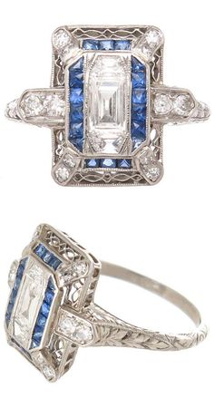 Art Deco Diamond Sapphire Platinum Ring. Centrally set with a step cut diamond approximately 1/4 carat and flanked on either side by a step cut trapezoid Diamond, further set with round diamonds and Swiss cut Sapphires. The gallery and shank are detailed with deep hand engraved workmanship. Circa 1930s, USA.