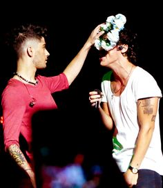 this part in the video was hilarious cuz zayn threw thr crown down and harry looked a little sad but then went off singing