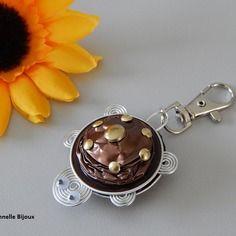 Bijou de sac ou porte clés forme tortue avec capsules nespresso marron