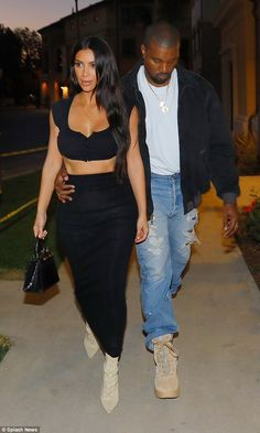 The Keeping Up With The Kardashians standout was seen planting a kiss on her Yeezy designer spouse, who she celebrated a wedding anniversary with last month, as they strolled.