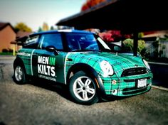 The Men In Kilts Window Cleaning BMW Tartan Mini. No Peeking! Love their logo and fresh marketing idea!