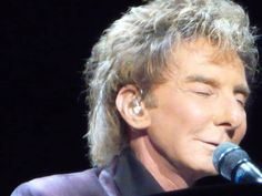 Barry Manilow on stage.