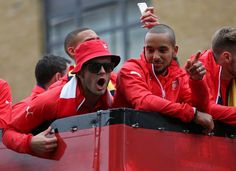 Jack Wilshere and Theo Walcott celebrate winning the FA Cup during the parade