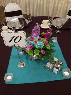 Stephanie and Brian's wedding centerpieces! #flowers #weddingideas #centerpiece #capriottiscatering #capriottispalazzo #summerwedding