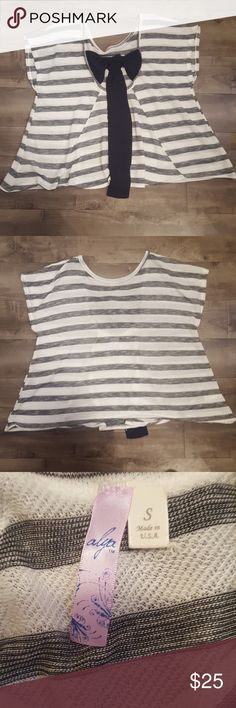 Black and white stripe sweater with bow back Black and white stripe sheer sweater with bow back.  Size S. Length is approximately 23 inches, width 22 inches. alya Tops