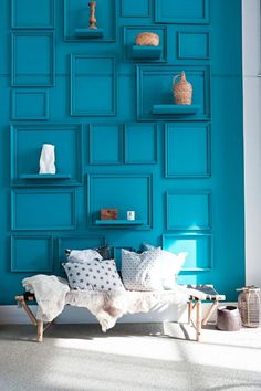 """Empty picture frames painted the same color as the teal walls and accented with shelves add interest to a boring wall and lend a funky, """"I live in an art installation"""" vibe - LOVE this!"""
