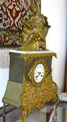 A Louis Philippe gilt and patinated bronze figural mantle clock