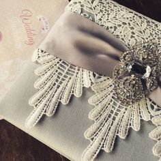 Lace Wedding Invitations Featuring Silver Dupioni Silk, Ivory Lace, Vintage Crystal Brooch