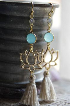These beautiful long lotus earrings feature clear sparkly crystals, aqua chalcedony stones (from Brazil), golden lotus flowers with beige cotton tassels below. They are approximately 8.3 cm | 3.2 long and 1.9 cm | 0.7 wide. Handmade in Australia. All jewellery comes gift wrapped and ready for giving.  Back to shop: www.etsy.com/au/shop/BoandHo