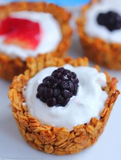 No added oil & easy to make healthy breakfast cups with just 6 ingredients, can be filled with anything you choose, such as yogurt and fresh berries, sliced banana and chocolate chips, or fill each one with something different to make everyone happy at the breakfast table. Recipe here: http://chocolatecoveredkatie.com/2015/01/06/customizable-breakfast-granola-cups/