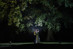 Bride and groom posing at night in the grounds of Swynford Manor