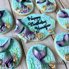 Edible Iridescent green & purple fondant tails on turquoise blue royal icing sugar cookies, made by Bunnycakes #birthday #sugarcookies #fondantart #royalicingcookies #partyideas #mermaidparty #beachparty #mermaidart #mermaidbirthday #decoratedcookies