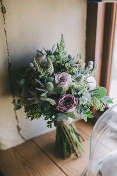 Lilac roses, thistle and wildflowers make for a super feminine wedding bouquet, tied in traditional French style with a single ribbon. Via Sally T Photography and Swallow & Damsons