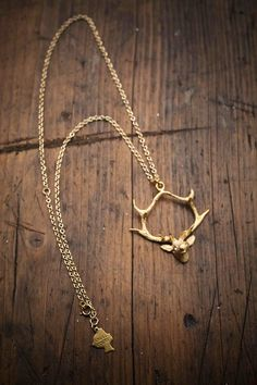 Gold Hanging Deer Necklace from Angel Court and Bourbon & Boots