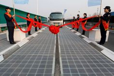 A vehicle is seen on a solar panel expressway during its opening in Jinan, Shandong province, China. - REUTERS/Stringer