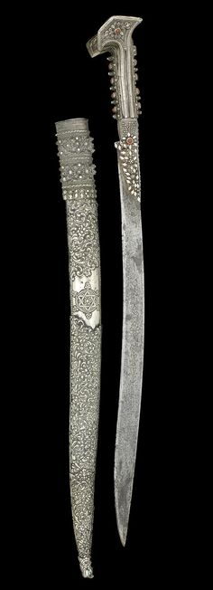 An Ottoman coral-mounted steel Yataghan Turkey, dated AH 1216/ AD 1801-2.  | © Bonhams 2001-2014