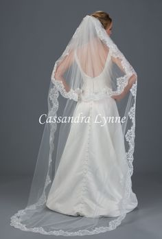 This chapel length bridal veil is designed with two layers of a delicate wide lace of flowery vines. The shortest layer is 30 inches, the longest layer is 90 inches, 72 inches wide and standard cut on