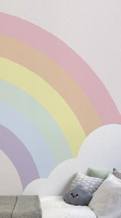 Let your child's imagination run free with this colourful wallpaper design. The Kids Pastel Rainbow Wallpaper Mural features a rainbow in pastel colours with a fluffy white cloud set against a pastel pink background. Designed by a team of in-house designers, this cute mural will create a calming space for your little prince or princess. #wallpaper #murals #wallmurals #interior #design #home #homedecor #decor #accentwall #inspiration #bedroomdesign