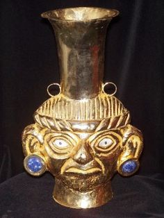 Peruvian ceremonial vaso Inca, made of copper and gold layer of 18K.  The stones in the piece are semi precious gems: turquoise (green) ; onyx (black) , and Lapis Lazuli (strong blue) . In others are Nacre (white) , and spondylus (pink) . Width: 25 cms; height: 33 cms; Weight: 500 grs.