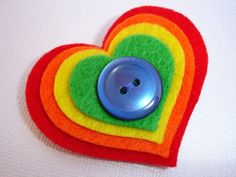 New Markdowns - Rainbow Heart clippie - red orange yellow green heart felt hair clip with blue button center  - non slip grip. $2.49, via Etsy.