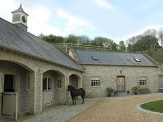 Great idea to inset the doors of the stalls, leave the windows open without the rain getting in :) horse stables Equestrian Stables, Horse Stables, Horse Barns, Dream Stables, Dream Barn, House With Stables, Holiday Cottages To Rent, Stone Barns, Horse Property
