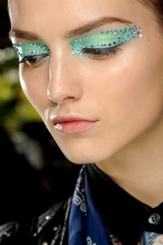 Dramatic eye color and applications, but very natural lashes... Glowy skin, no lip color