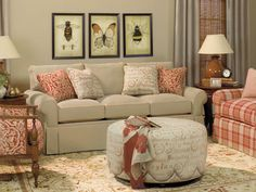 I like the look of the sofa being a solid color and the love seat being plaid.