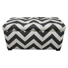 "Perfect for stowing throws in the living room or board games in the den, this wood-framed storage ottoman showcases a chic black and white chevron motif.   Product: Storage bench Construction Material: Wood and upholstery fabricColor: Black and white   Features: Beautifully crafted silhouette    Dimensions: 20"" H x 37"" W x 19"" D  Cleaning and Care: Clean with a soft cloth"