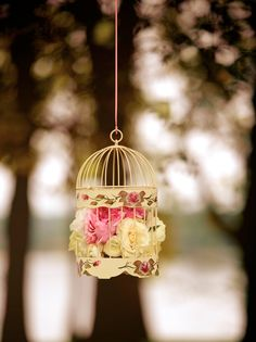 Remove the bird from the cage and stuff some flowers inside. Remember this is your day, not the bird's!!