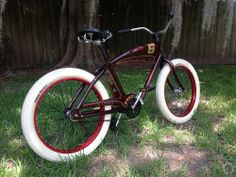 Sweet deep maroon Felt with white thick brick tyres and red rims #cruiser
