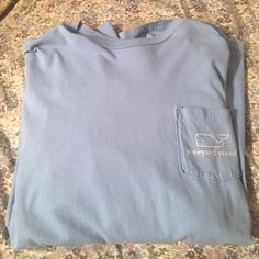 Long sleeve vineyard vines Long sleeves vineyard vines blue shirt. It has a whale on the back, logo on the front, and the name on the left sleeve. Men's size medium but can fit girls or boys. No stains. Vineyard Vines Tops Tees - Long Sleeve