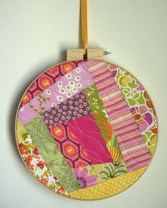 quilted embroidery frame wall art from the queen of recyling's blog...Betz White.  Love this idea!