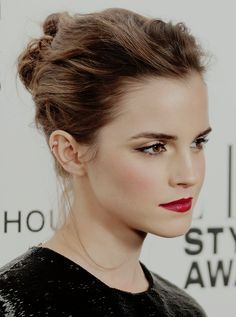 Emma Watson's red carpet hair, make-up & jewellery with her Giambattista Valli (Spring 2014) Couture black sequin top and bow fronted skirt at the ELLE Style Awards in London, February 2014.