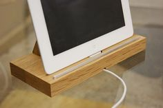 oak ipad stand / tablet docking station by mijmoj design limited | notonthehighstreet.com