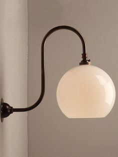 Our Handblown white glass Hereford shade is exclusive to Fritz Fryer and looks fantastic on our Swan Neck Wall light Contemporary Wall Lights, Modern Contemporary, Wall Light Fittings, Hereford, Modern Glass, Glass Globe, Modern Industrial, Colored Glass, Glass Shades