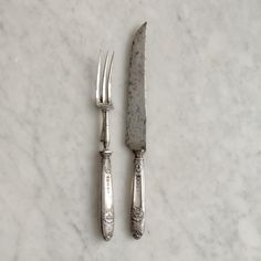 Parisian Classic Carving Set - 175 E https://thecooksatelier.com/the-french-larder/vintage/curlicue-knife-and-fork-