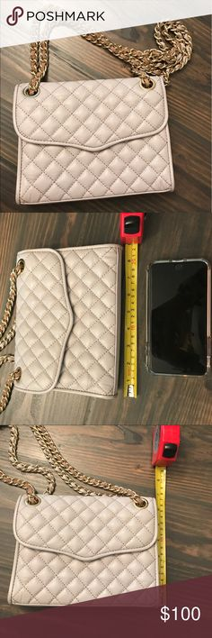 Grey Taupe Rebecca Minkoff quilted leather purse Authentic Rebecca Minkoff quilted leather convertible purse. Grey taupe color. Chain gold and can be worn short for shoulder bag or long for crossbody. One interior pocket no zipper. No signs of wear and tear. Used only a few times. Rebecca Minkoff Bags Shoulder Bags