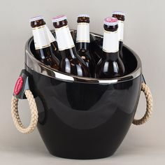 BEER ICE BUCKET - An elegant design for a drinks bucket with easy carry handles. Neatly fits six bottles.