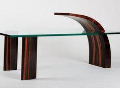 Designer et ébéniste, Eric Wilmot dessine et fabrique des meubles à la fois beaux, originaux et fonctionnels. Le bois devient une couleur, pour mettre en valeur des formes souvent épurées et sculpturales et provoquer une relation émotionnelle et sensorielle. Son atelier est installé à la ferme de la Visitation à Ornans. >>> www.ericwilmot.fr