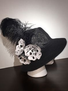Kentucky Derby Hat inspired by Kate Spade. Hat features ostrich feather, glitter Spade and flowers made out of Spade playing cards.