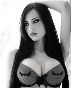 Sexy vampire. I hate that bra, but I like the makeup and eyes and the idea of the drops of blood on the chest.