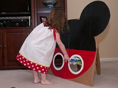 Mickey Mouse bean bag toss-with pink and white polka dots on bottom and add bow for minnie! YES!. Thinking I need to get kev on this for another fun activity for the kiddos! :)
