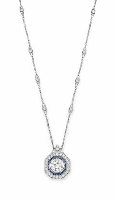 AN ART DECO DIAMOND AND SAPPHIRE PENDANT NECKLACE Suspending a pendant set with an old European-cut diamond, within a calibré-cut sapphire and old European-cut diamond surround, mounted in platinum, to the fine link neckchain, enhanced with collet-set diamonds, clasp mounted in white gold, circa 1925