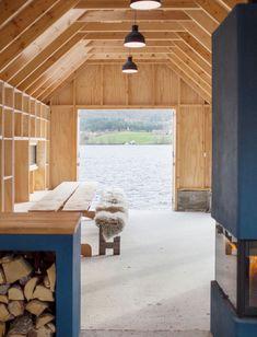 kolab and koreo architects revitalizes timber boathouse in norway