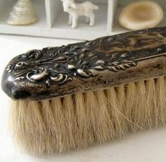 Sterling Silver Brush - have husband's from infancy....qualifies as antique....shhhh