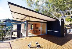 another fibro reno -Warm and welcoming ... floor-to-ceiling glazing has been used in all north facing rooms of this Avoca Beach ''shack'', while inside blackbutt  is a feature.