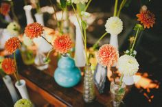Ask everyone to contribute a few cool vases or we could find some at a flea market/vintage store and that makes farmers market flowers even cuter/easier!