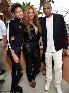 Risque: Beyonce (center) sported a deep plunging jumpsuit to the bash, at which she posed alongside husband Jay Z (right) and Willow Smith (left)