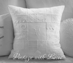 White patchwork pillow made from linen and laces